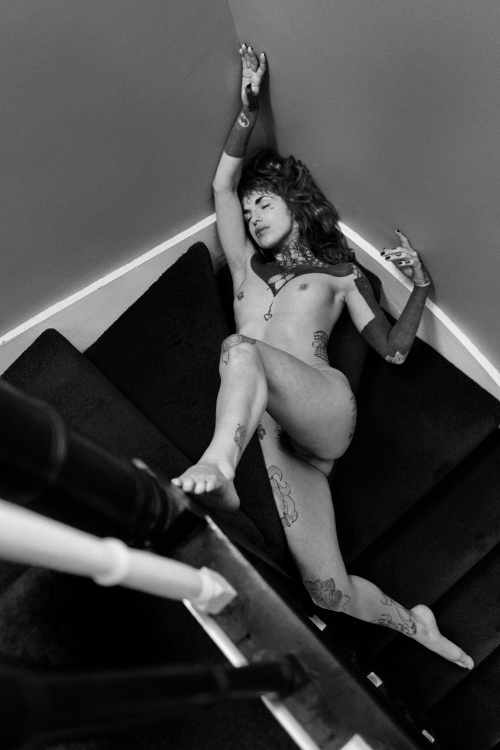 Chloe Tink nude model on stairs